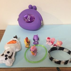 Girl's change purse with jewelry and small toys